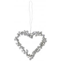 Un petit coeur de perles blanches